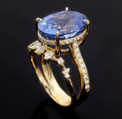 Ring with large blue stone and custom setting