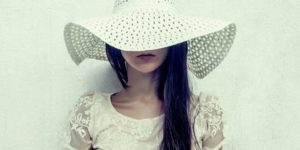 Styling the lace trend — woman wearing lace dress and hat