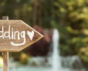 Wooden sign for outdoor wedding