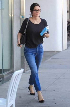 Courtney Cox wearing jeans and black t shirt