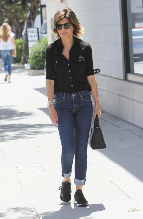 Lisa Rinna wearing jeans and black top