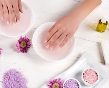 Nail salon table with woman's hands