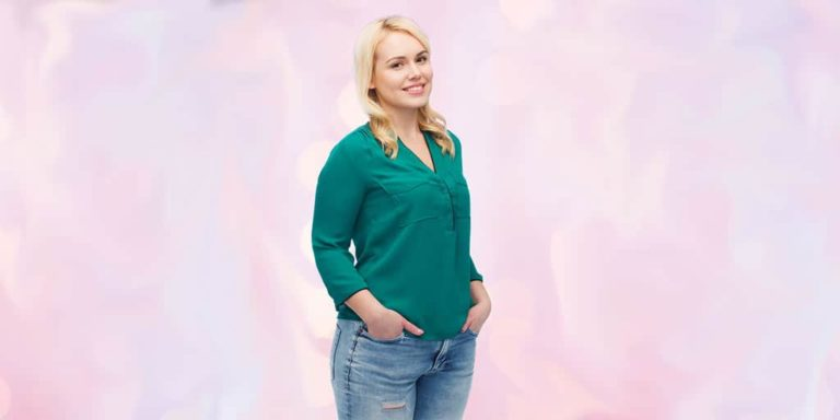 Managing wardrobe through weight changes -- pretty woman wearing jeans and green top