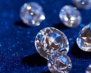 White diamonds on a sparkly blue background