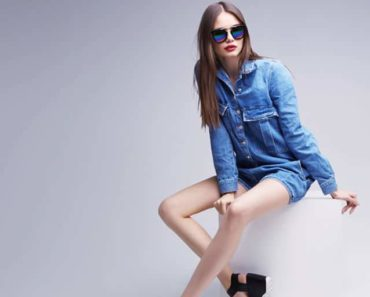 Woman wearing sunglasses and denim outfit