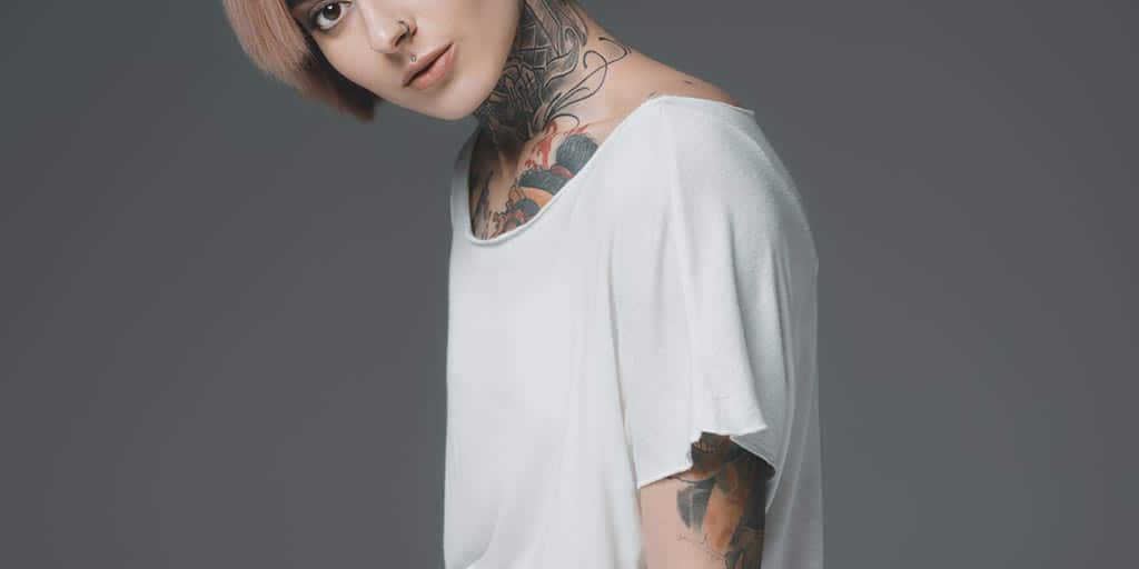 Tattooed woman wearing white tee shirt
