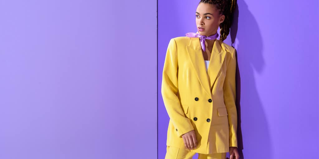 Woman in bright yellow suit