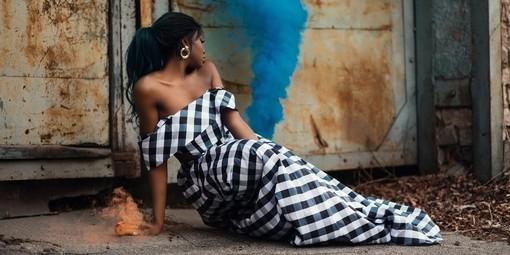 Woman wearing plaid patterned dress