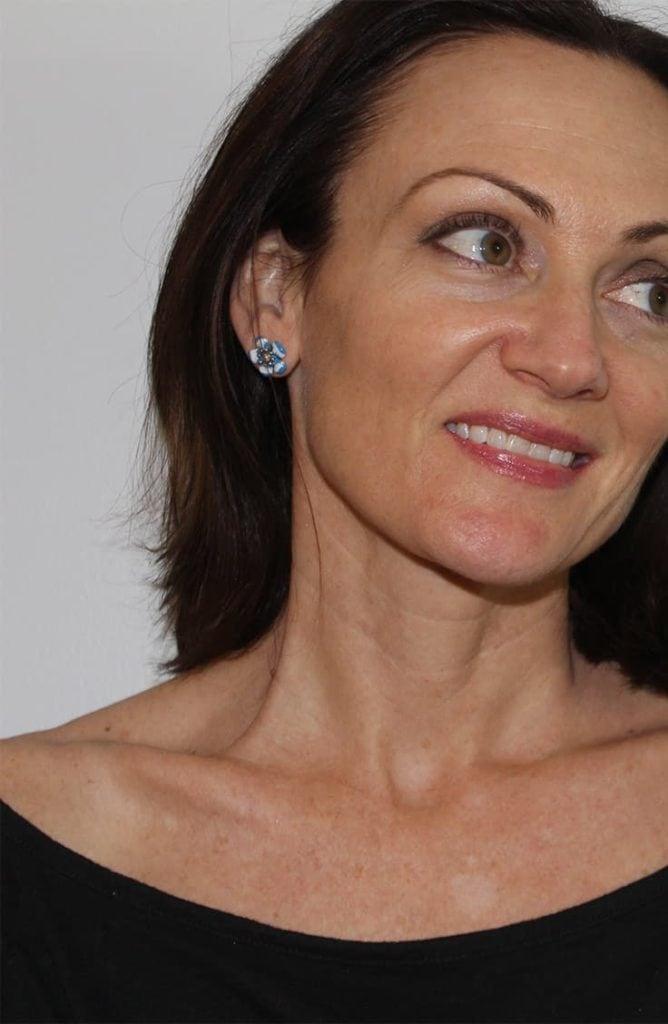 Catherine Brock wearing mid range jewelry line Ana Luisa jewelry
