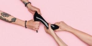 Women fighting over a pair of black heels