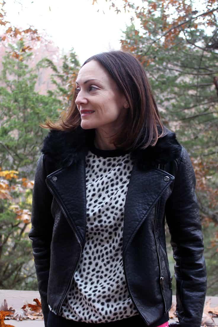 Catherine Brock wearing polka dot top with moto jacket