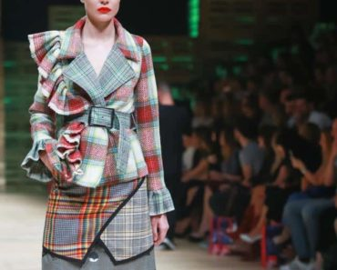 Runway model wearing patterned outfit