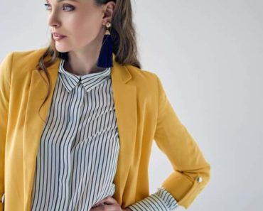 Woman wearing yellow blazer and striped top