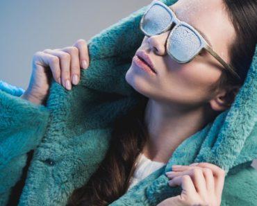 Winter coat trends — woman wearing fuzzy green coat