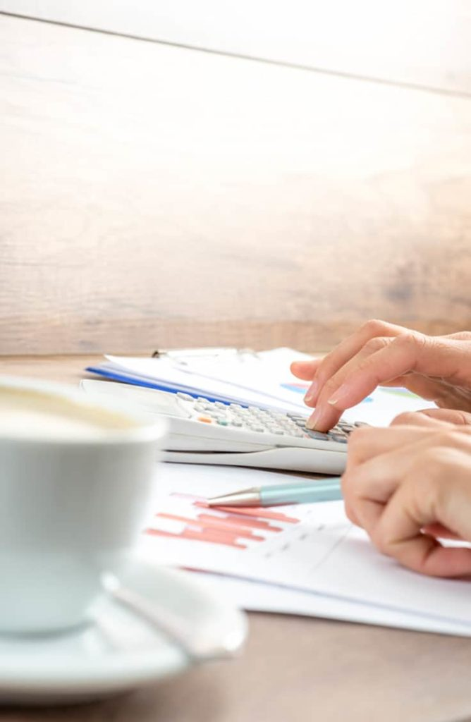 Ways to save —close up of woman budgeting