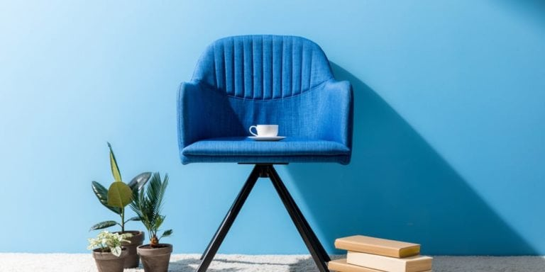 Minimalist home decor style -- blue chair against blue wall