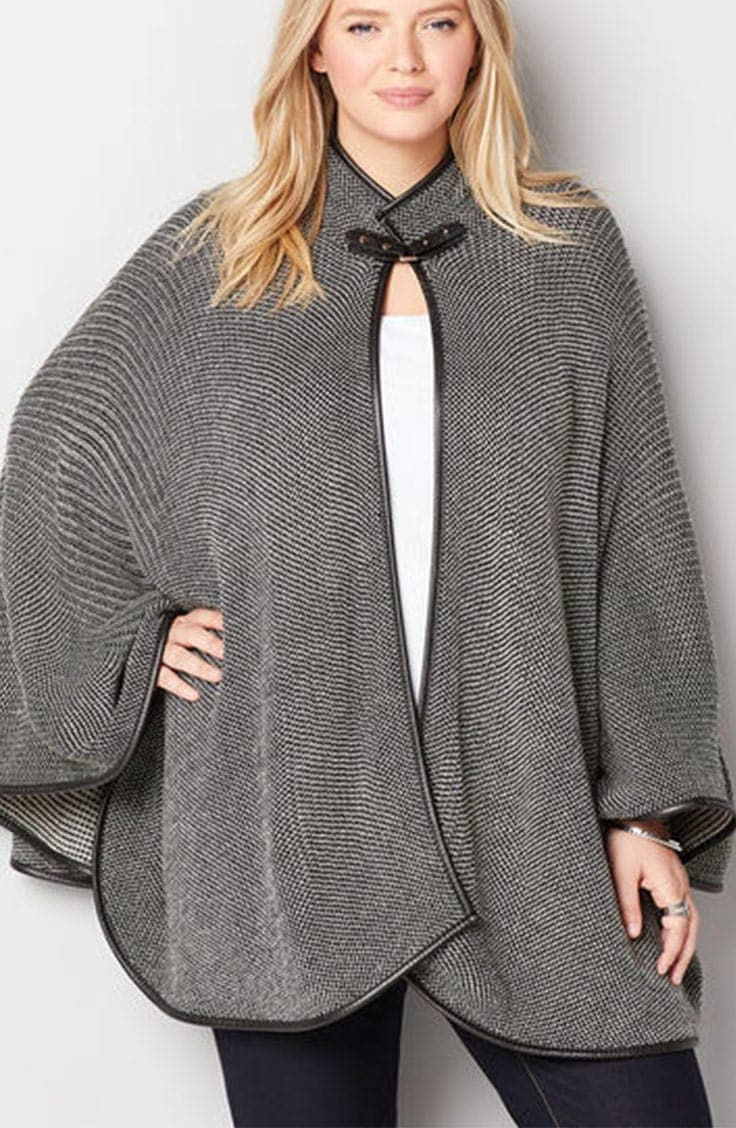 Woman wearing gray cape