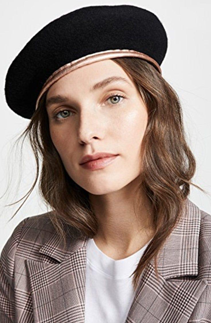 Black beret with gold trim