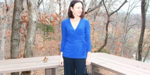 Catherine Brock wearing wrap top and wide legged pants
