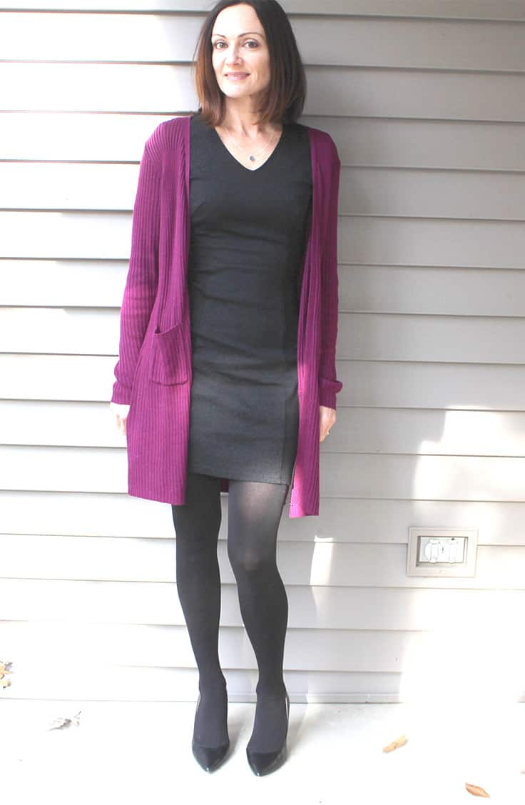 Catherine Brock wearing sheath dress and long cardigan