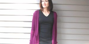 Catherine Brock wearing long cardigan and sheath dress
