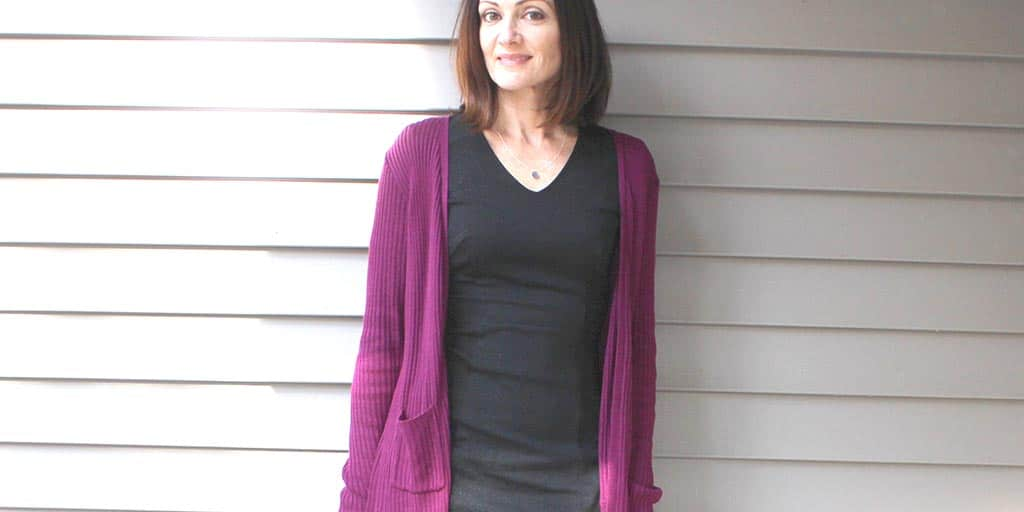 Catherine Brock wearing long cardigan and sheath dress