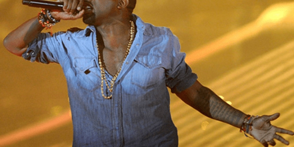 Kanye WEst wearing a denim ombre shirt