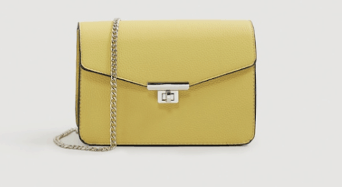 yellow cross body bag with chain