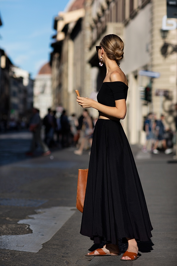 Woman wearing black crop top and maxi skirt