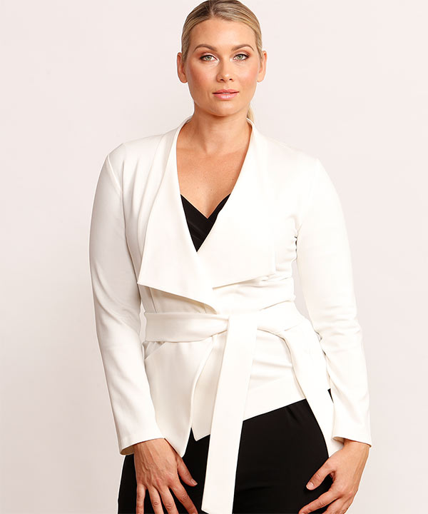 Woman wearing white wrap coat with short hemline