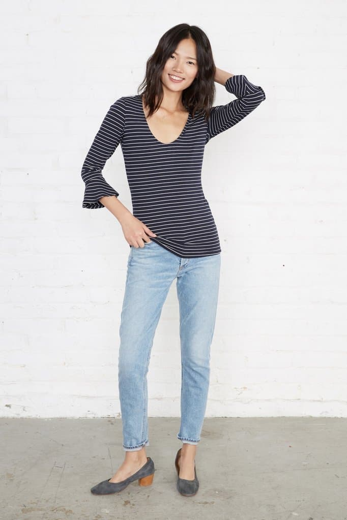 Brunette wearing striped top and jeans