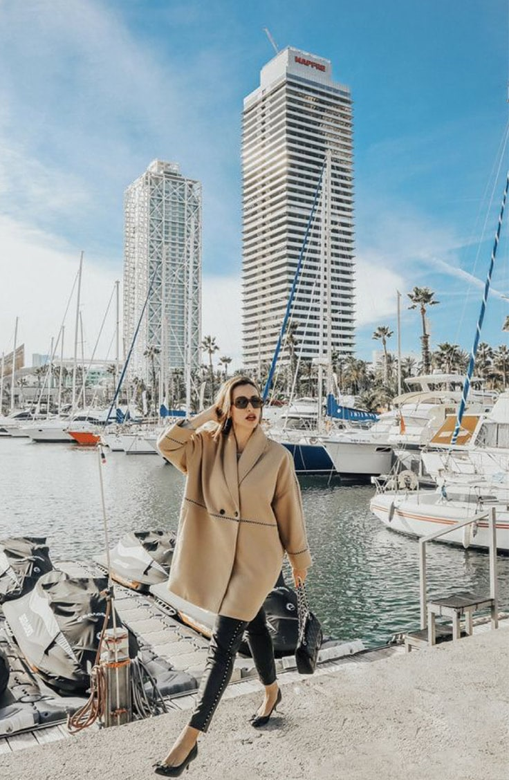 Zlatina Jekova style blogger wearing a cape at a marina