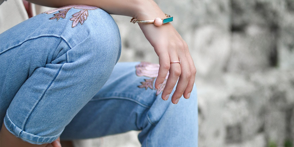 close up of embroidered jeans