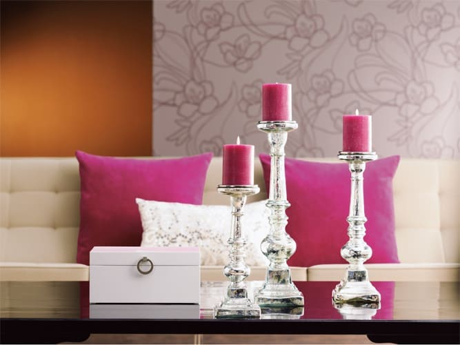 candle holders, decorative box and pink pillows