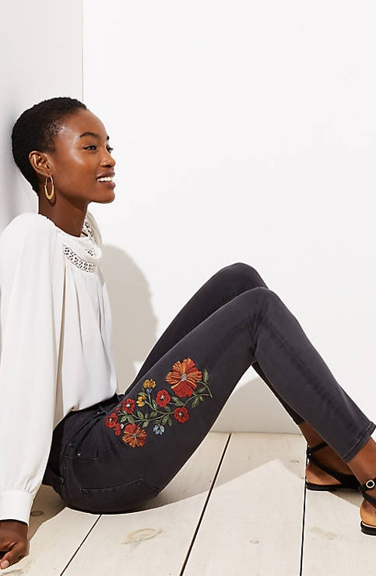 Black skinny jeans with floral embroidery