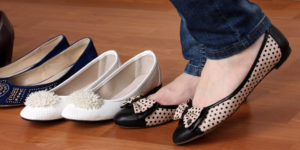 Close up of woman trying on flat shoes