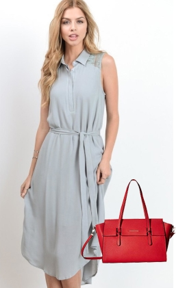 Woman in blue dress with bright red purse