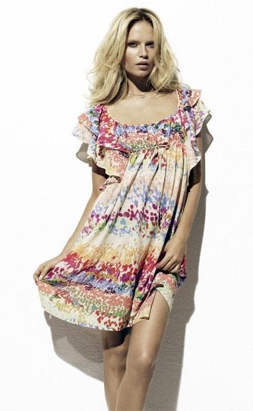 Woman wearing patterned, ruffled dress