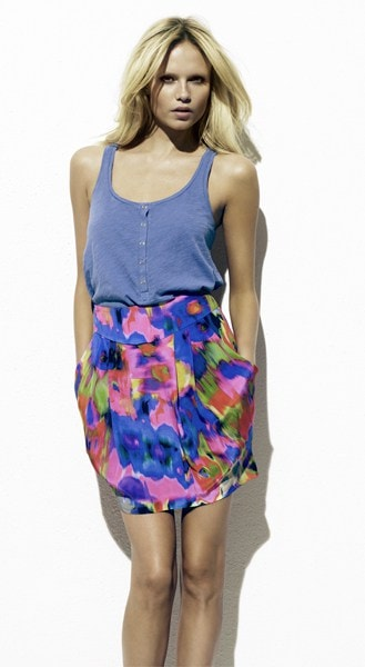 Woman wearing blue tank top and floral skirt
