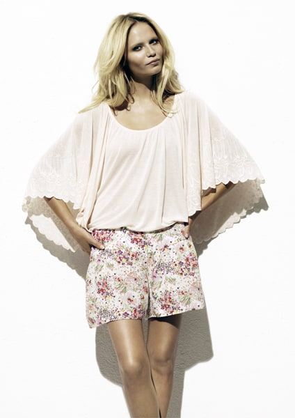 Woman wearing loose top and floral shorts