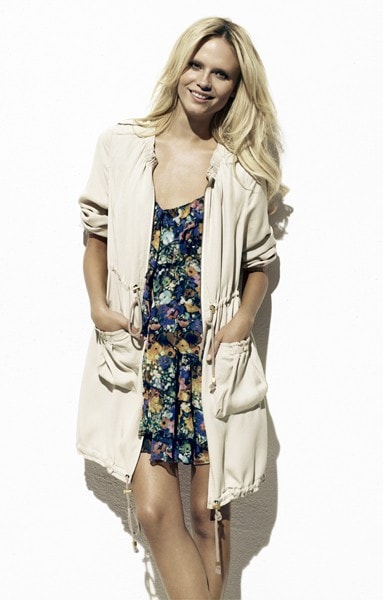Woman wearing casual jacket over floral dress