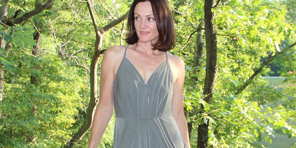 Catherine Brock wearing draped green dress from Le Tote