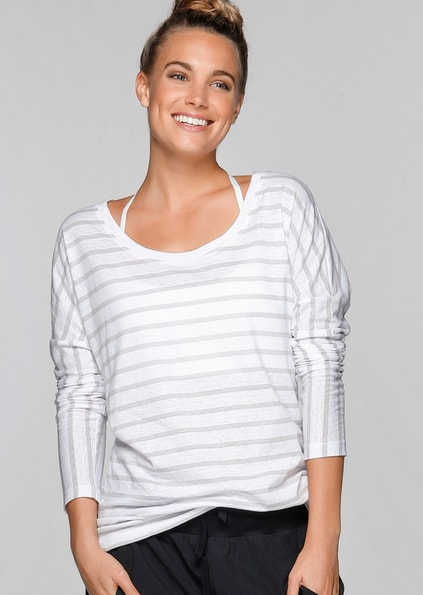 Woman wearing white striped long-sleeved t shirt