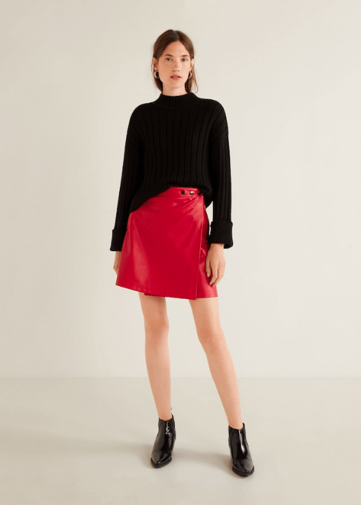 Woman wearing bright red leather skirt