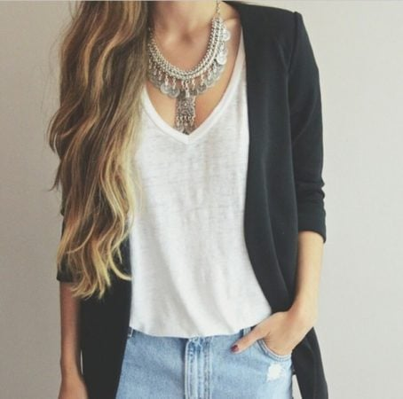 Woman wearing necklace, tank top and cardigan