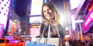 Woman shopping in New York at night
