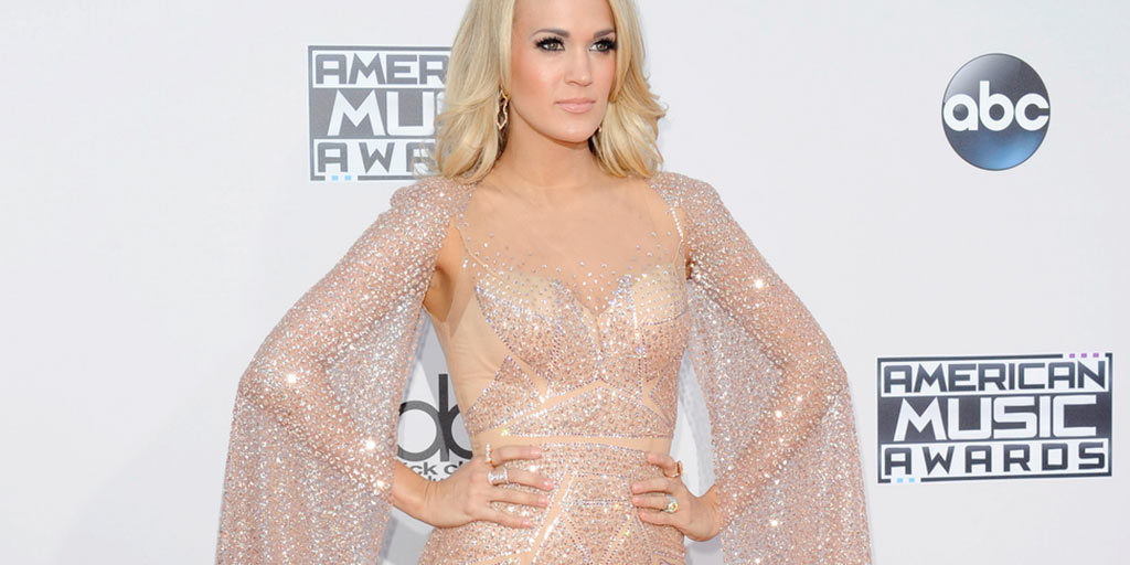 Carrie Underwood wearing nude sequined dress