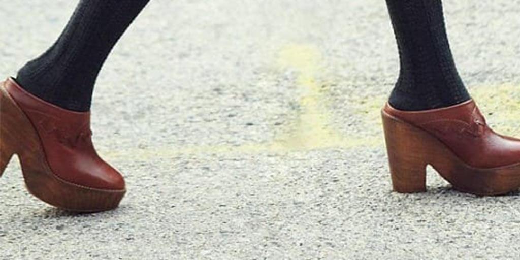 Woman walking on the street wearing platform shoes