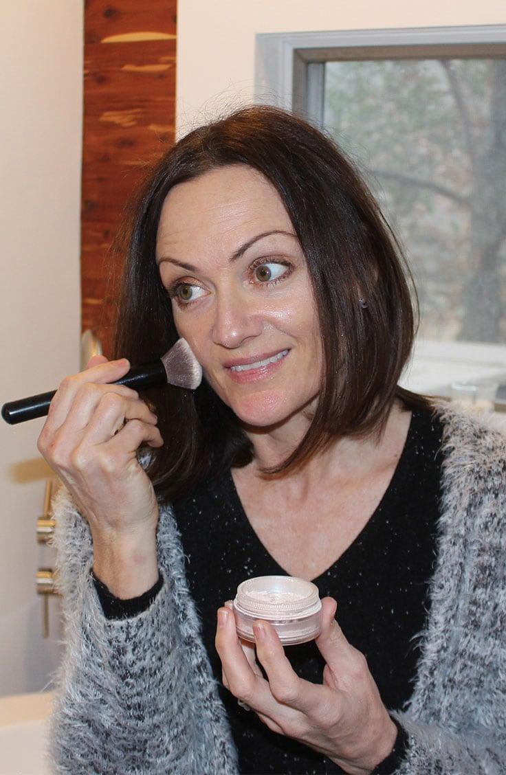 Catherine Brock applying Mineral Veil powder.