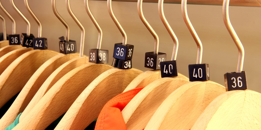 Clothes on hangers with sizes marked